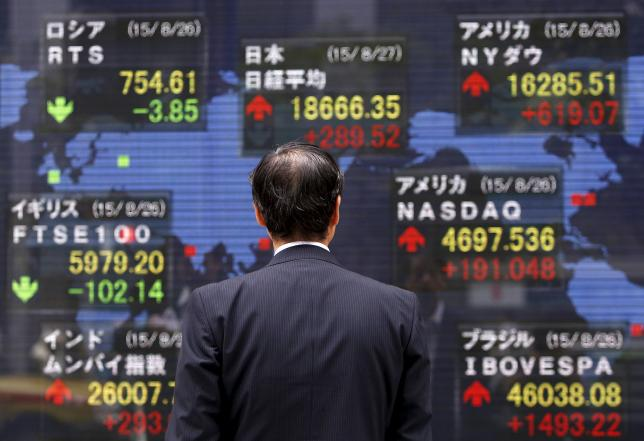 Asian shares hit three-week high ahead of crunch Fed meeting